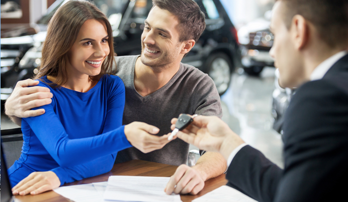 Photo of a couple buying a car
